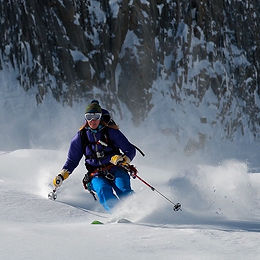 Liz Smart skiing powder in the Alps on a Women's Ski Camp