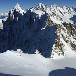 Skiing the first steep face of the Grand Envers from the Aiguile du Midi