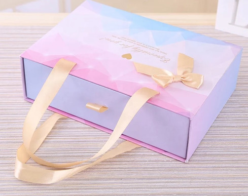 Baby Blue and Pretty Pink with champagne gold ribbon and bow