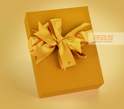 Luxurious gold packaging box with Ribbons Rigid Box from India