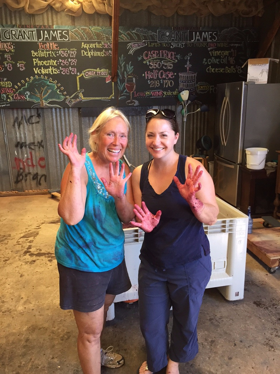 Mom (left) and Wendy (right), truly aren't afraid to get their hands dirty, or rather grapey and sticky.