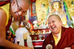 Her Eminence Mindrolling Jetsün Khandro Rinpoche laughs with Venerable Lama Konchok Sonam