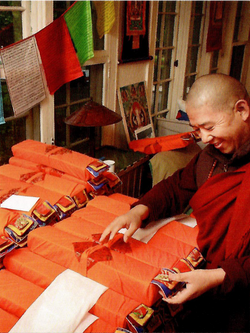 Ven. Lama Konchok Sonam with Kangyur and Tengyur texts