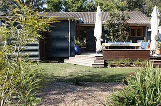 Back deck and garden Tui Cottages