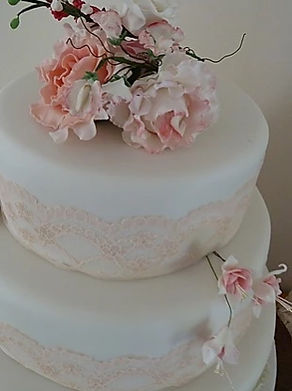 These beautiful handmade wedding cakes are made from the finest quality fresh ingredients and edible flowers.
