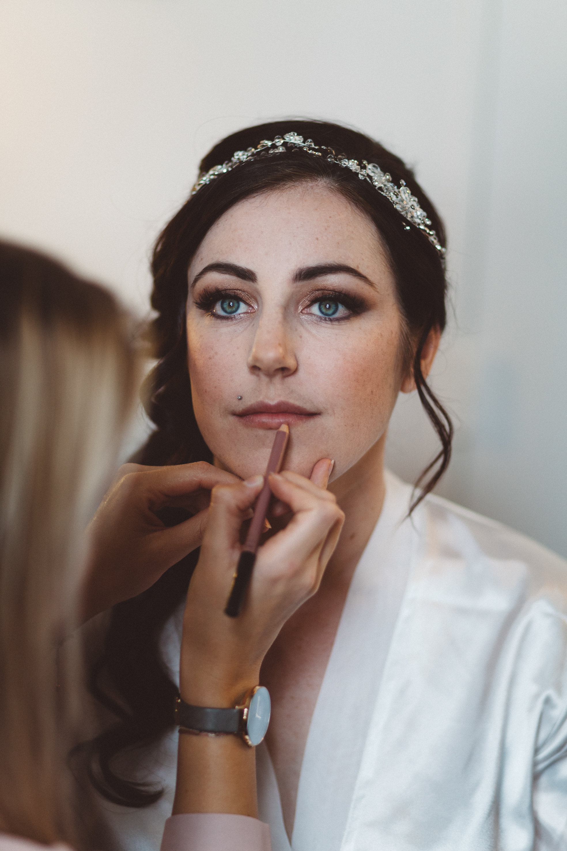 Final touches on bride Tamara
