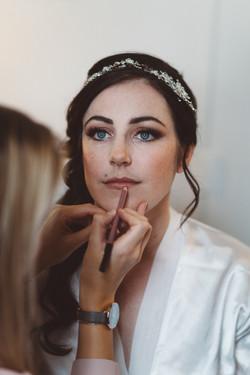 Final touches on bride Tamara