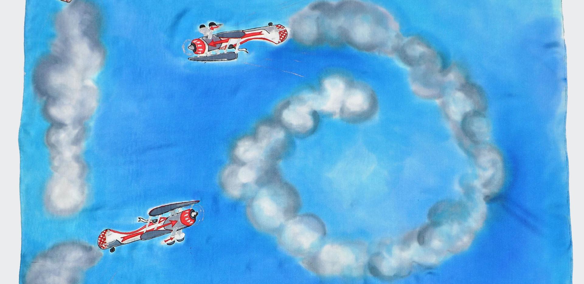 vol de coucous rouges sur fond bleu ciel