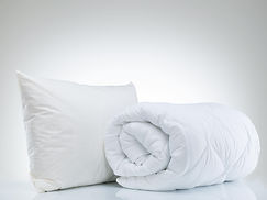 A freshly dry cleaned pillow and duvet.