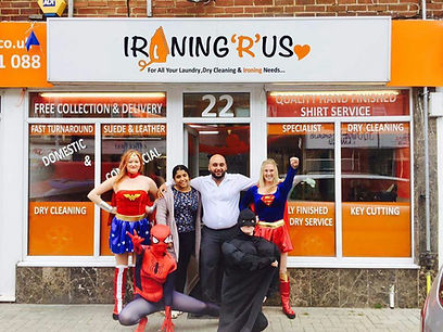 Ironing R Us shop front with the staff members posing together in front of the entrance.