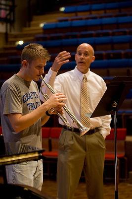 Doc as a trumpet coach.