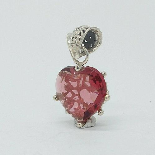 Silberner Anhänger mit rosa Swarovski-Herz gefasst in Silber