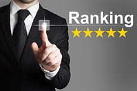 businessman in suite pushing button ranking five rating stars.jpg