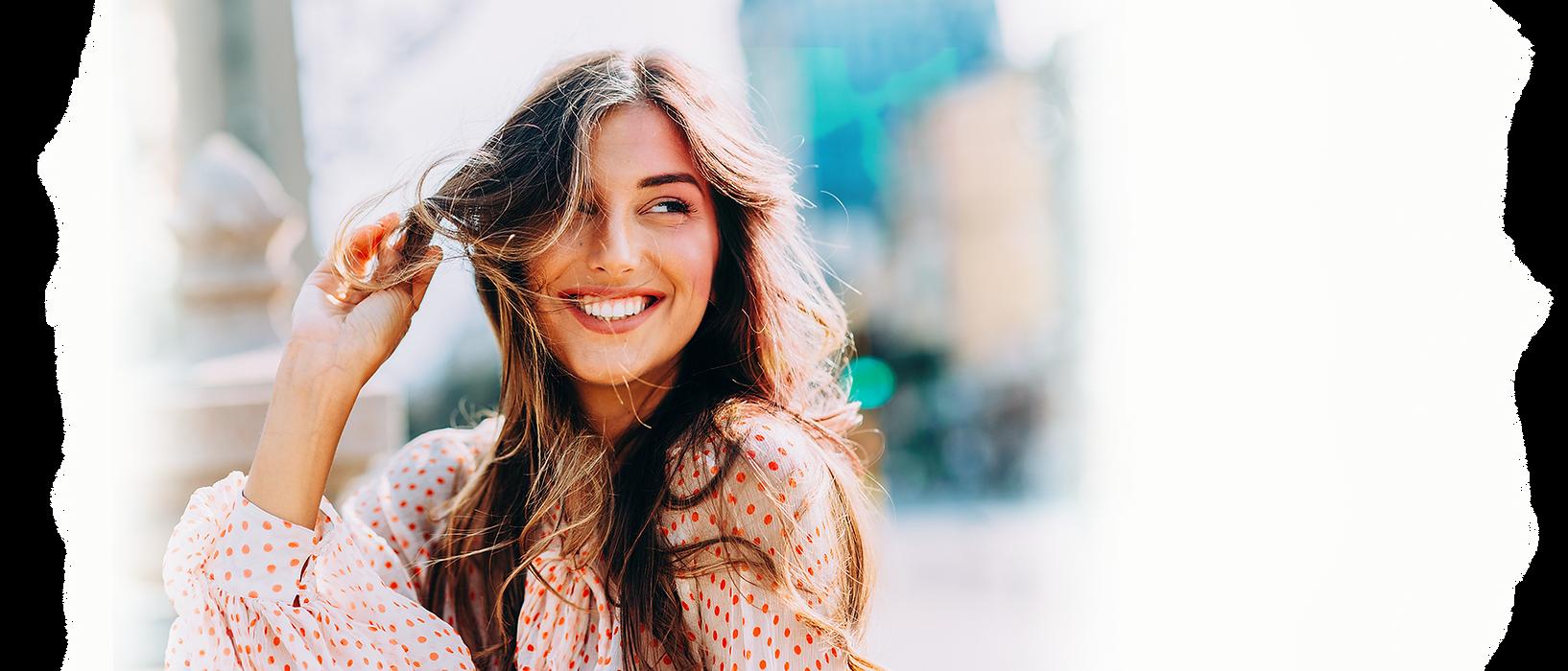 Beautiful woman smiling in polka-dot blouse