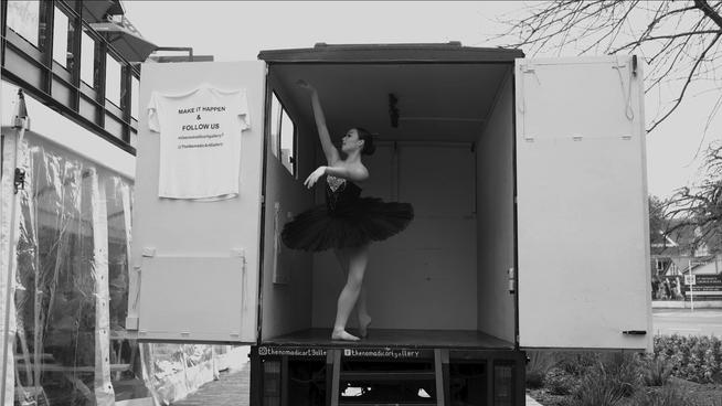 Sonia Woods dancing in the Nomadic Art Gallery