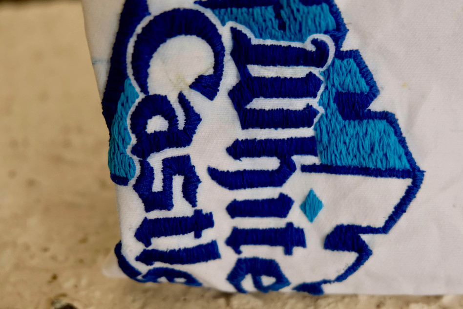 "Jay Hutchinson, White Castle from the series ""Broken concrete, American trash"", hand-embroidery on digitally printed cotton drill with found concrete (2020)."