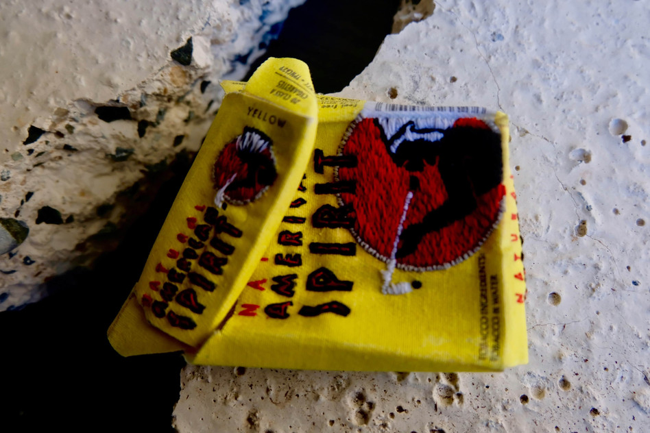 """Jay Hutchinson - American Spirit from the series """"Broken concrete, American trash"""" hand- embroidery on digitally printed cotton drill with found concrete (2020)."""