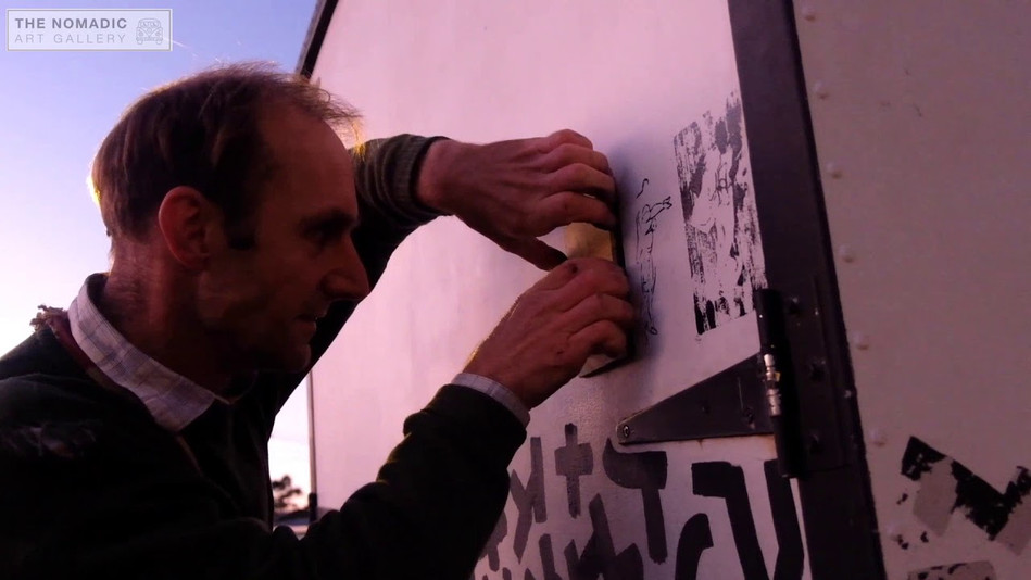 Manu Berry adding his woodcut prints
