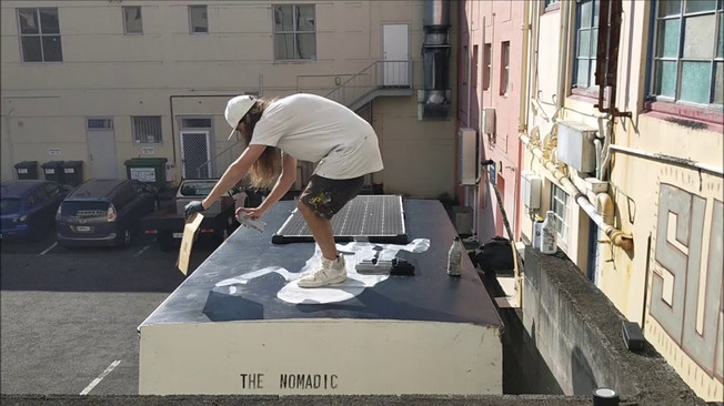Milarky live painting on the roof of the Nomadic Art Gallery