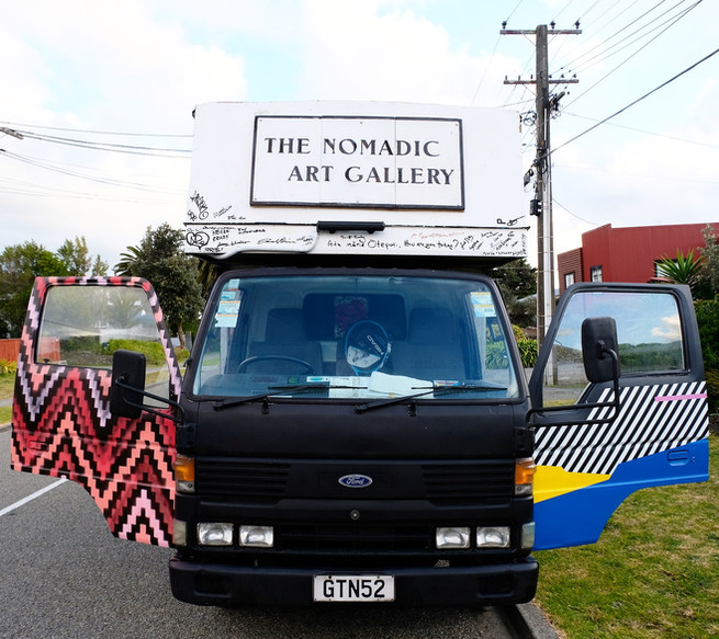 Dr Suits addition onto the truck's public participatory artwork next to the work by Aroha Novak