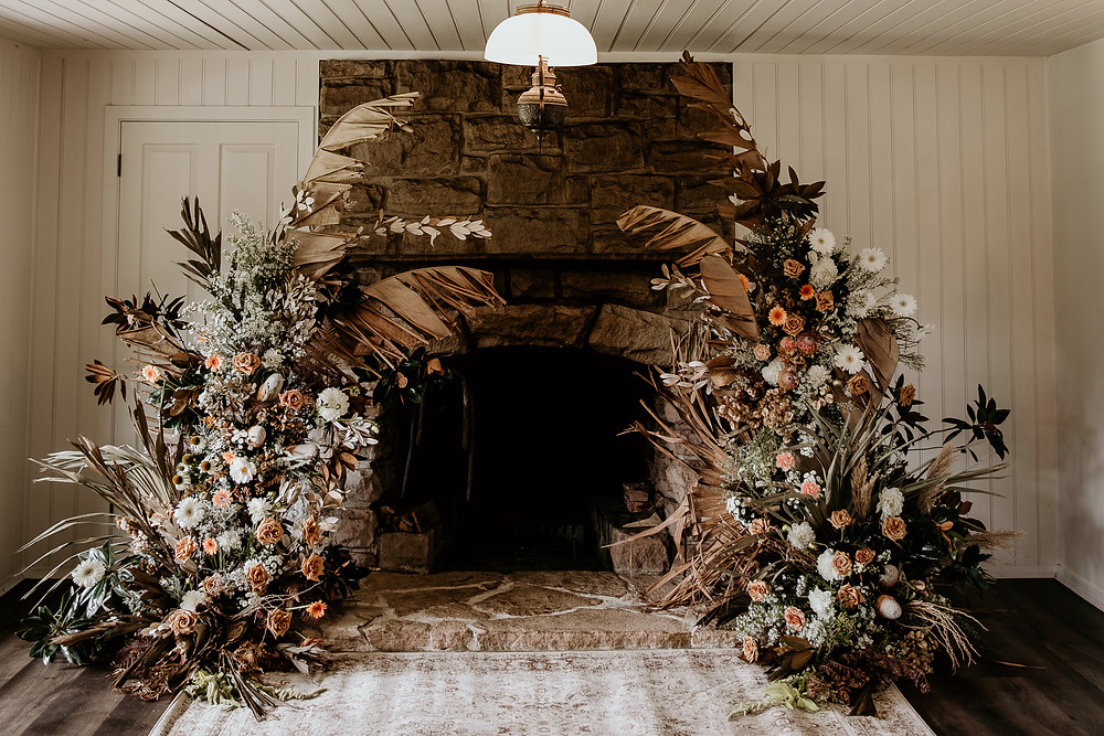 A two piece arbour setting the scene in an indoor microwedding ceremony
