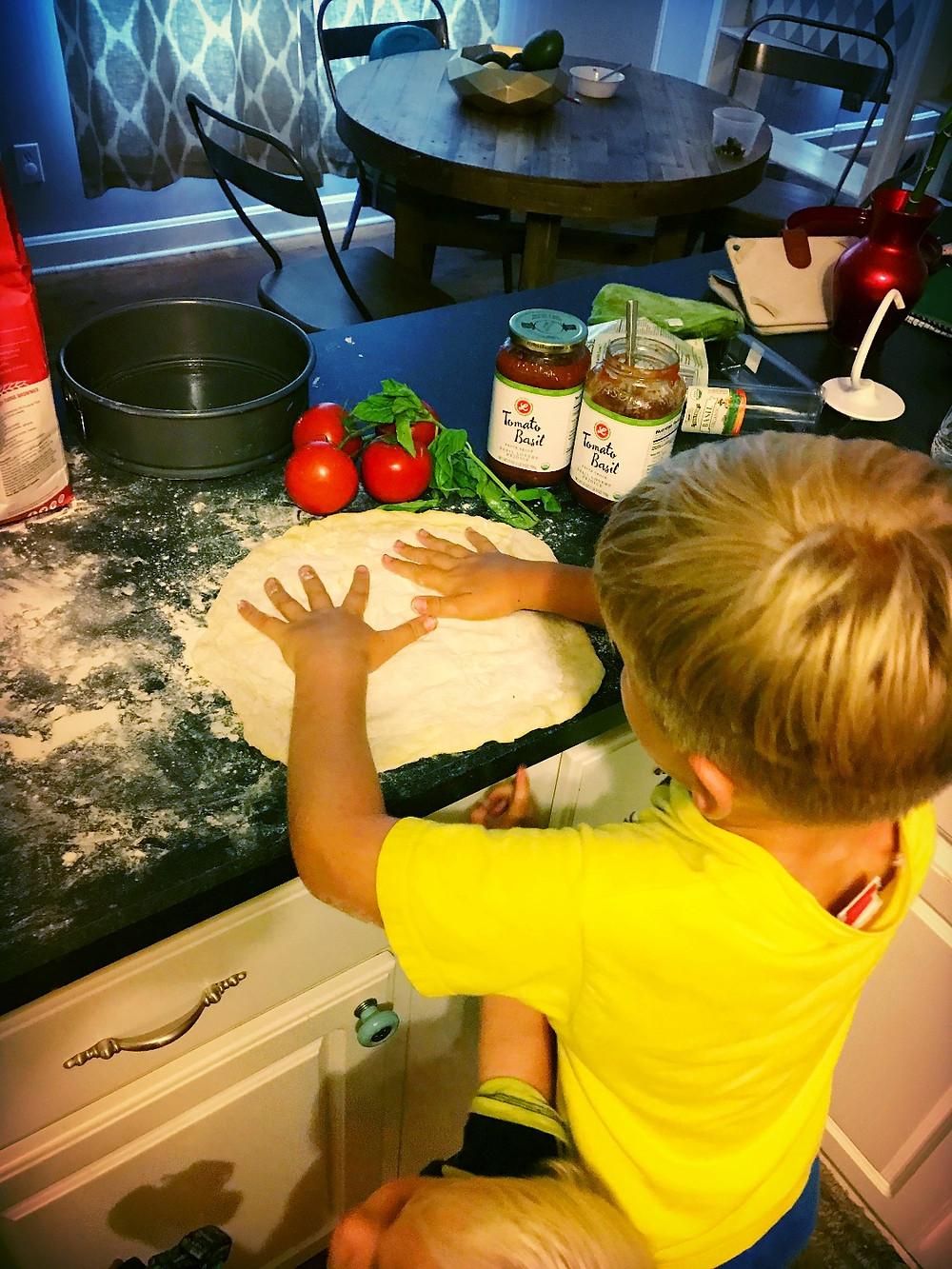 Boys lending a helping hand.