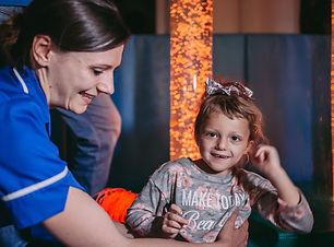 Kaycee age five in sensory room