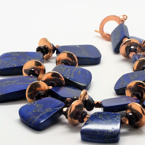 Graduated lapis rhomboids with copper and garnets