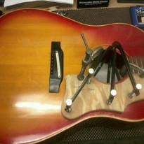 Gibson pick guard re-glue