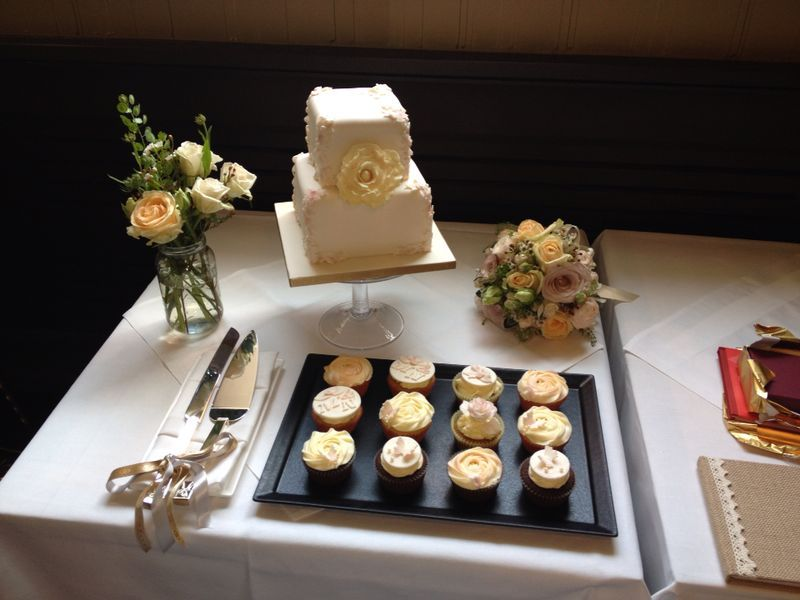Elegant Wedding cake and Cupcakes