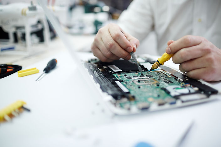 repairing-circuit-board-in-laptop.jpg