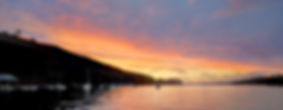 Wide panorama sunset at Lake Sunapee from Newbury Harbor New Hampshire. Photograph by Ken Schuster.