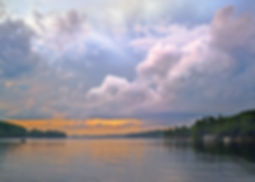 Sunset on Lake Sunapee NH after a stormy day. Photograph by Ken Schuster.