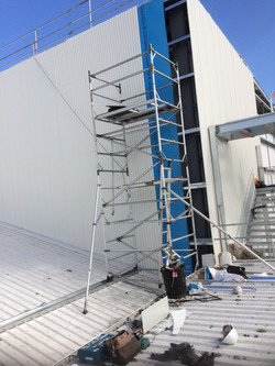 Install Wall Cladding for New Roof