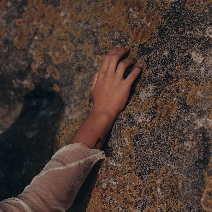 person-touching-rock-2029267_edited.jpg