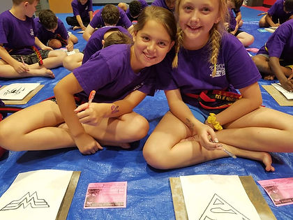 Two Summer Campers Enjoying Pottery Works.