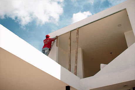 man%20in%20red%20jacket%20standing%20on%20white%20concrete%20building%20under%20blue%20and%20white%2