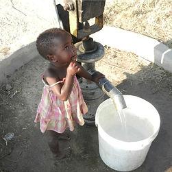 Zimbabwean girl at water pump