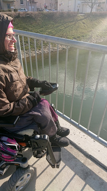 Tina s svojim šalom na sprehodu opazuje živali ob Ljubljanici.  She is looking at flowers, because she loves them very much.