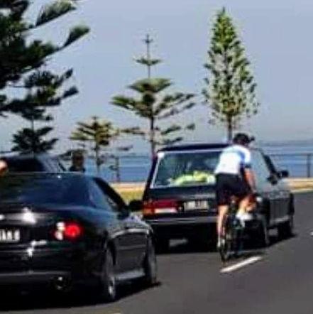 Following Yvonne's hearse on a bicyvle.j