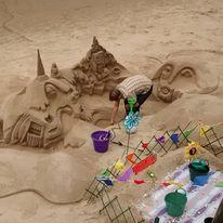 Artist building Sand Sculpture in London
