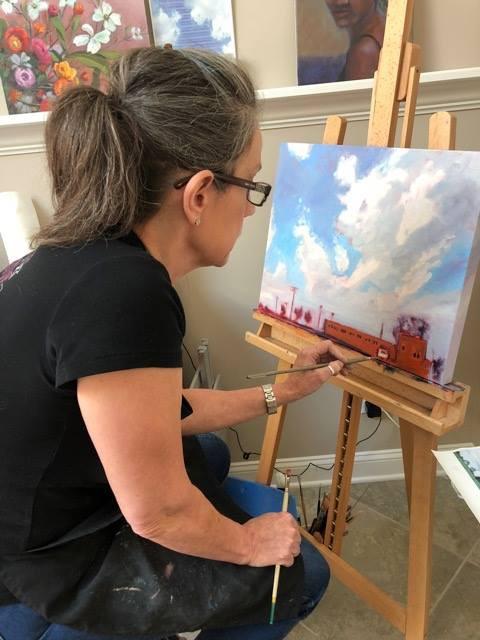 Artist Sonya Diimmler working at her easel