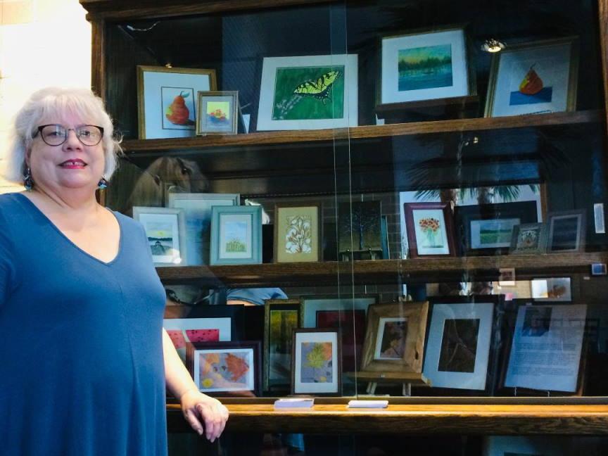 Photo of artwork in display cabinet - left side