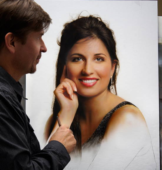 Photo of Dru Blair working on a painting