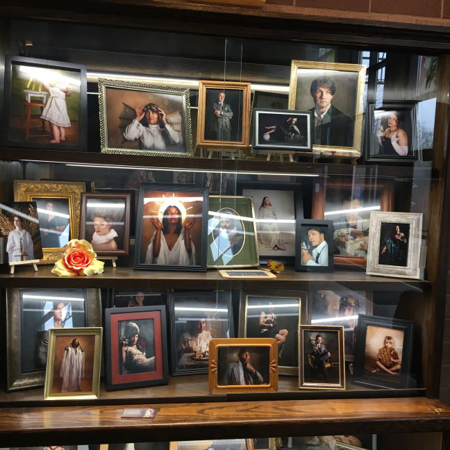 Photo of photography display by Kimberly Case