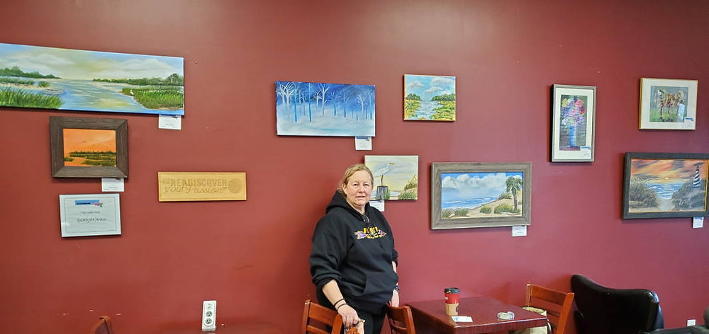 Margie Shelburg with her exhibit at the Coffee Shelf