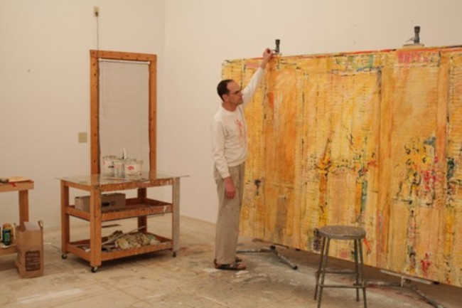 "Artist Photo: Philip Mullen with painting ""Praises 2"""