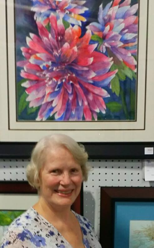 """Ruby Haydock-DeLoach at South Carolina State Fair  with her watercolor painting """"Fire and Ice 1"""""""