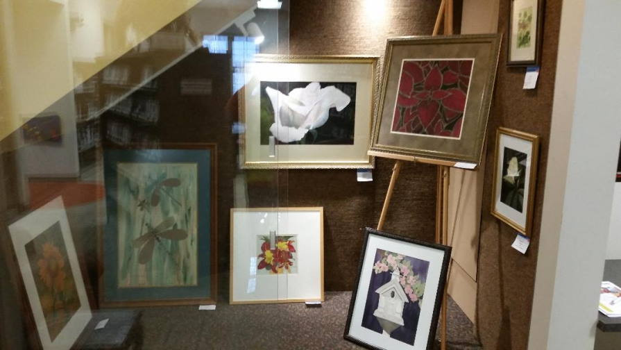 Display of floral artwork by Adelia Shirer Ruth in Chapin Library Gallery