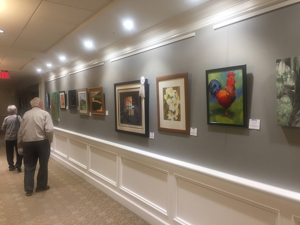 Photo of CCAL Fall Exhibition Hallway with artwork